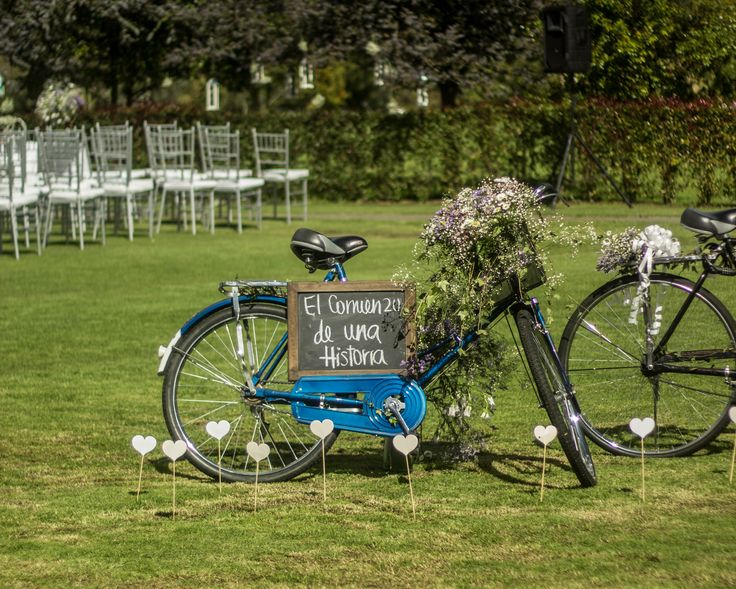 Bride´s bicycle decorated with wild flowers + the begging of a history chalk sign