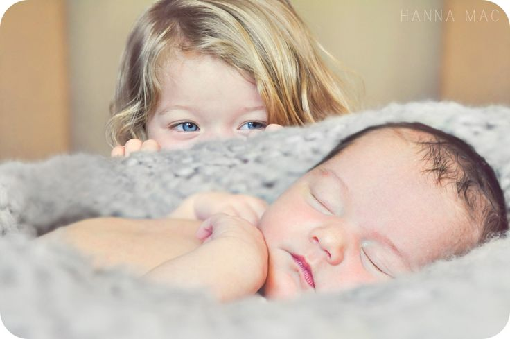 We absolutely love this sweet big sister moment as a photo idea for your announcement!