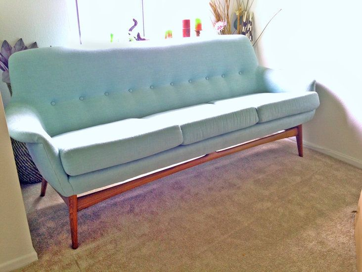 Amazing very rare danish mid century sofa for sale! I'm not sure who the manufacturer is but I haven't seen another one like it! The upholstery is relatively new and is a teal greenish bl...