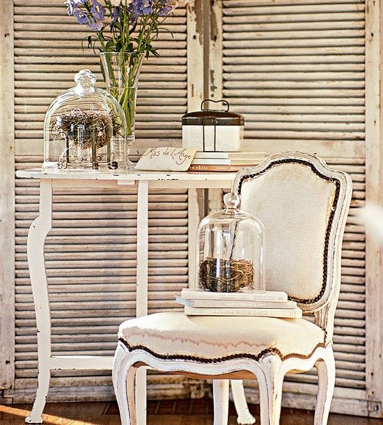 Home Decorating Tips - Create Vignettes: A pair of large louvered shutters creates the feel of a mini room. Use this technique to create intimacy and charm, with both large arrangements of furniture as well as smaller displays of accessories. Highlight special pieces by isolating them. Here, sparkling glass cloches (bell jars) cover little bird?s nests with a bit of style and shine.