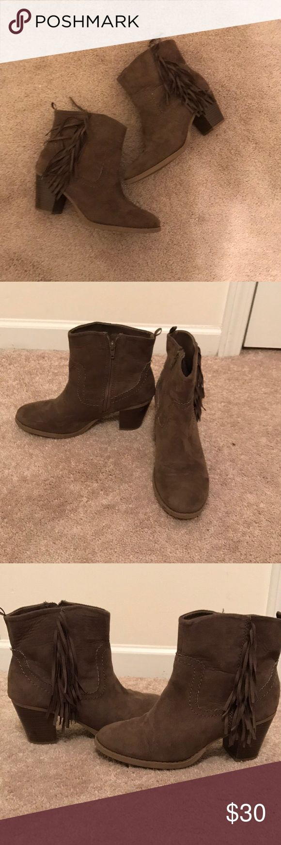 GAP Tan fringe booties GAP tan fringe booties. Super adorable! Side zipper to make putting them on easier. In great condition. The right bootie has a tiny speck of dirt. Can only see if you really look for it. The heels are a little scuffed up as shown in pic. Heel is 2 1/2 inches. Suede like material. GAP Shoes Ankle Boots & Booties