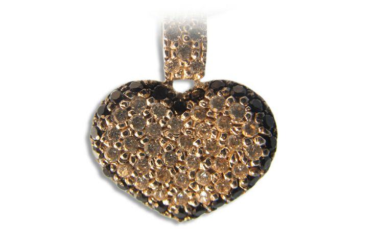 18 karat gold heart designer pendant.