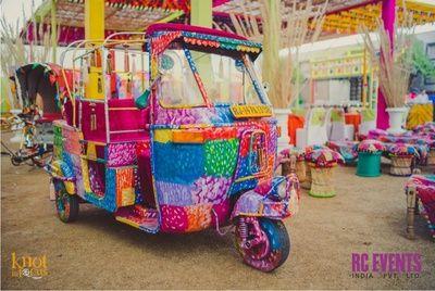 colourful auto , multicoloured auto , fun props , dholki ight , sangeet night , colourful cane stools , village theme  , photo booth, village theme, funky decor, kitsch decor, multicolored