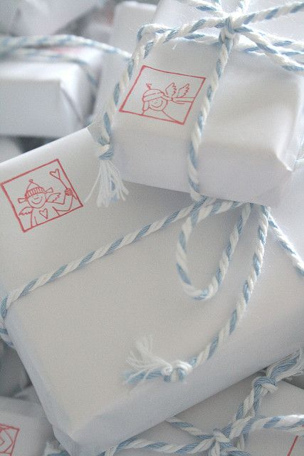 packaging with white wrapping paper, baker's twine and stamps - simply adorable