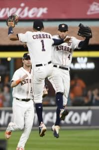 October 20, 2017:  Verlander, Altuve help Astros top Yanks to force ALCS Game 7.  Houston Astros' Carlos Correa and George Springer celebrate after Game 6 of baseball's American League Championship against the New York Yankees Series Friday, Oct. 20, 2017, in Houston. The Astros won 7-1 to tie the series at 3-3. (AP Photo/Eric Christian Smith)