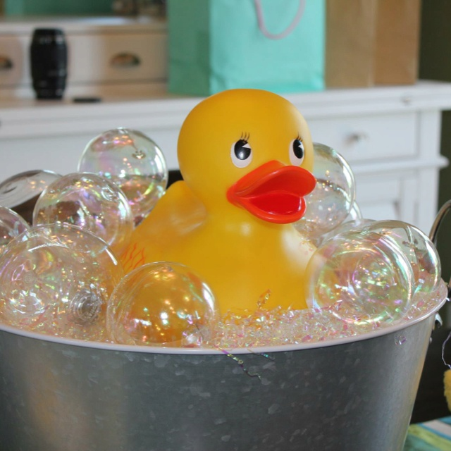 Rubber ducky bubble bath using clear, plastic iridescent ornaments and the iridescent filler you use in Easter baskets!