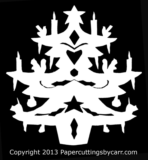 Scherenschnitte of a Christmas Tree, traditional papercutting, without patterns or sketches. By Lawson and Harriett Carr.