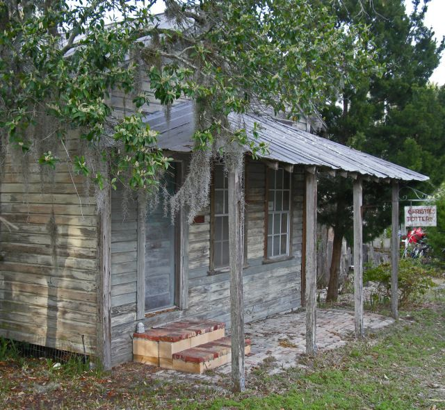 """""""Florida cracker architecture"""" is the name for a style of wood houses with metal roofs, raised floors, extensive porch areas and a central hall called a """"shotgun"""" or """"dog run"""" hallway."""