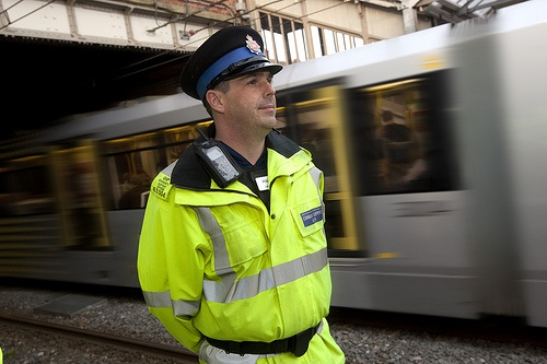 A police community support officer of Greater Manchester Police at work at one of the region's many Metrolink stations. The Greater Manchester Metrolink (light rail) system carries over 22 million people per year.  www.gmp.police.uk