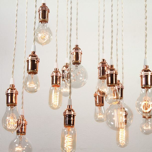 Vintage-style industrial filament bulbs on silk-bound flex: perfect for above the dining table. Try to source these in copper.