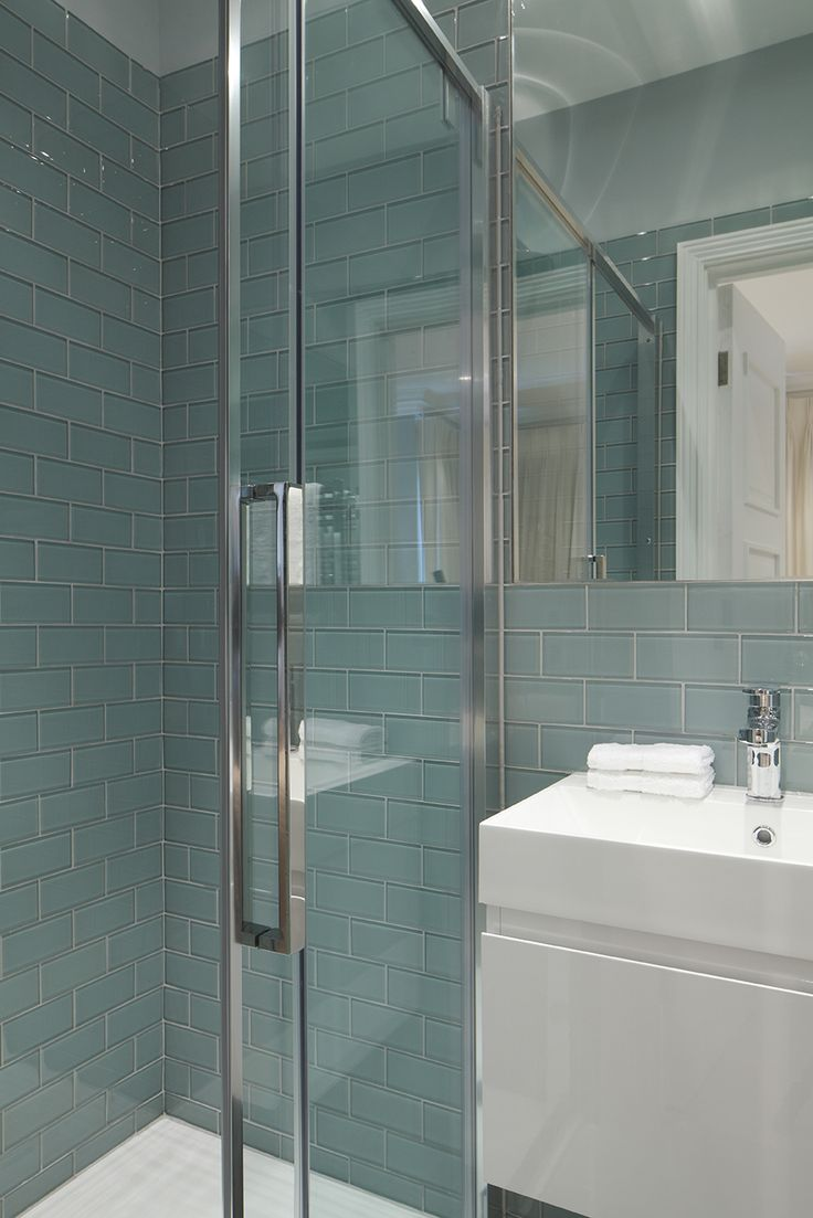 Turquoise tiled shower by Jess Lavers Design