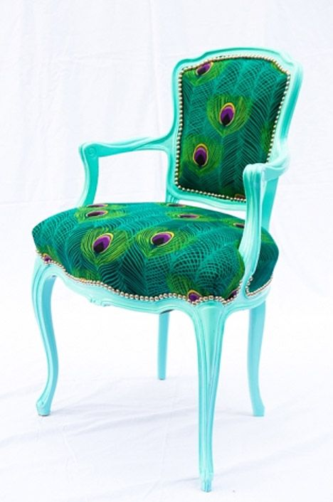 nnnneeeeeedddd..but sadly this fabric is 40 bucks a yard!!!!!!! So I found one thats silver with turquoise peacock feathers on it..not as cool..but i think ill be happy with it..8 bucks a yard is a little bit better for me, expecially when i need well over 3 yards to try and cover this massive chair that i have.