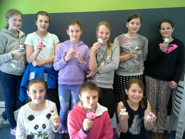 Students from Strathcona Baptist Girls Grammar in School Holiday Classes at Kew Neighbourhood Learning Centre.  Artistry in Icing, School of Cake Design, Melbourne. Cupcakes Mixed Designs using lollies #Baking #CakeDecorating #Classes #CakeDesign #Fondant # Piping Skills #