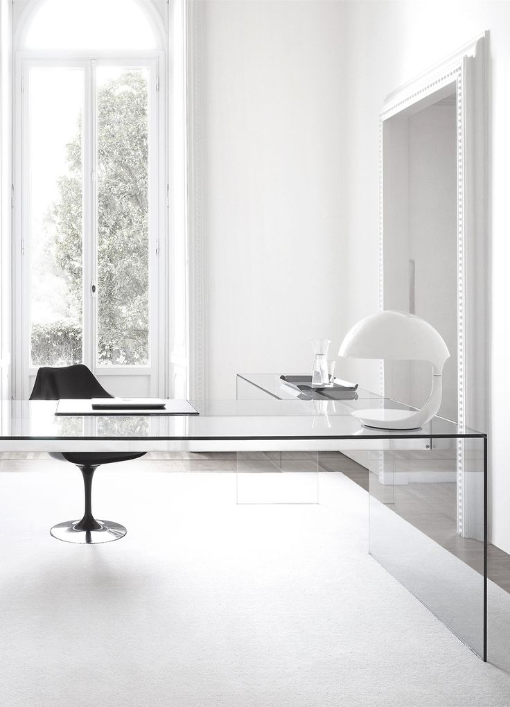 I like the simplicity of the glass desk.  (Where would all of Stefan's cords hide?!)