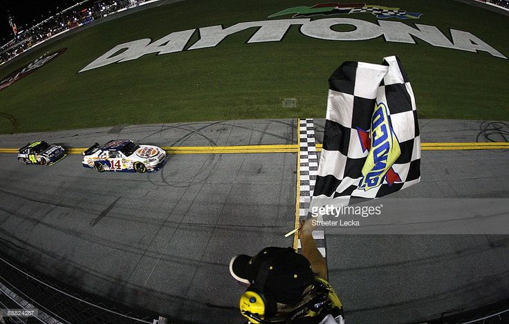 Tony Stewart, driver of the #14 Burger King Chevrolet, leads Jimmie Johnson, driver of the #48 Lowe's/Kobalt Tools Chevrolet, to win the NASCAR Sprint Cup Series 51st Annual Coke Zero 400 at Daytona International Speedway on July 4, 2009 in Daytona Beach, Florida.