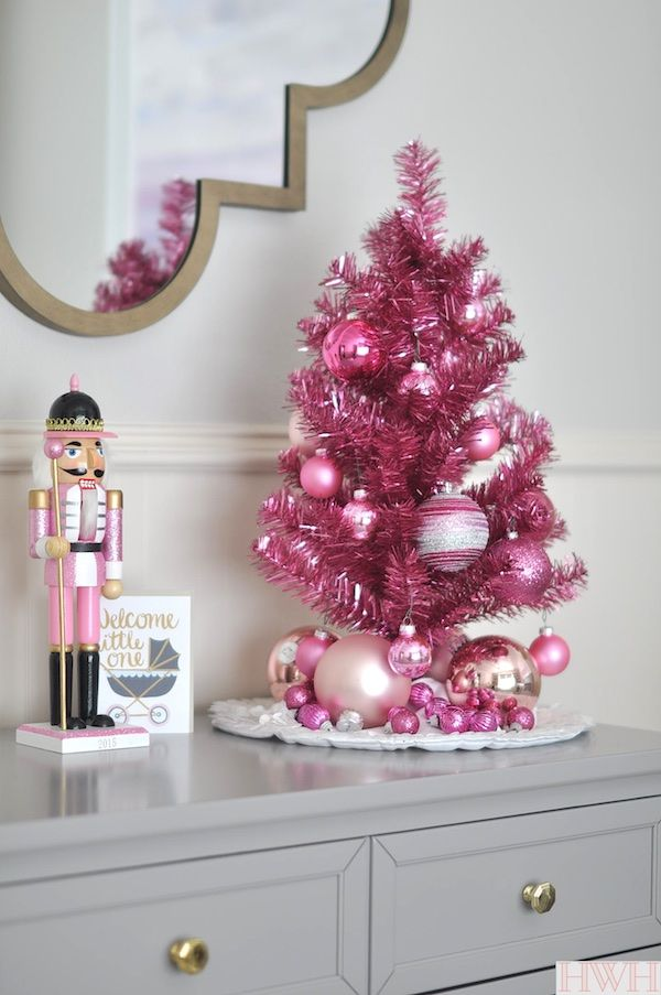 Festive holiday nursery with pink tinsel tree and pink nutcracker | Honey We're Home