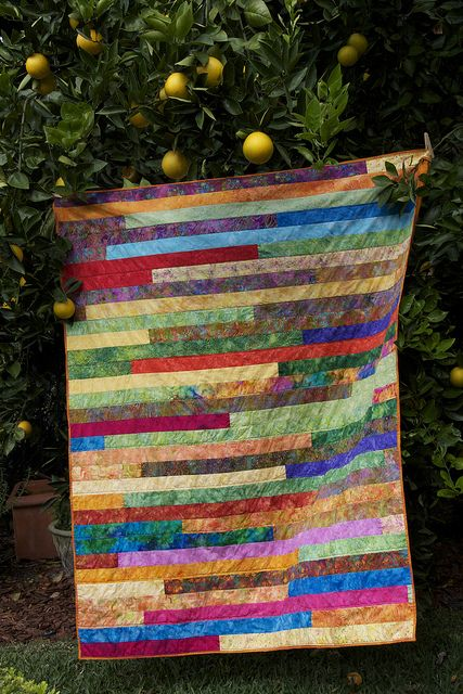 quilt; I really like this type of scrap quilt. How easy to just cut everything into strips and then sew them together.  Easier than squares.