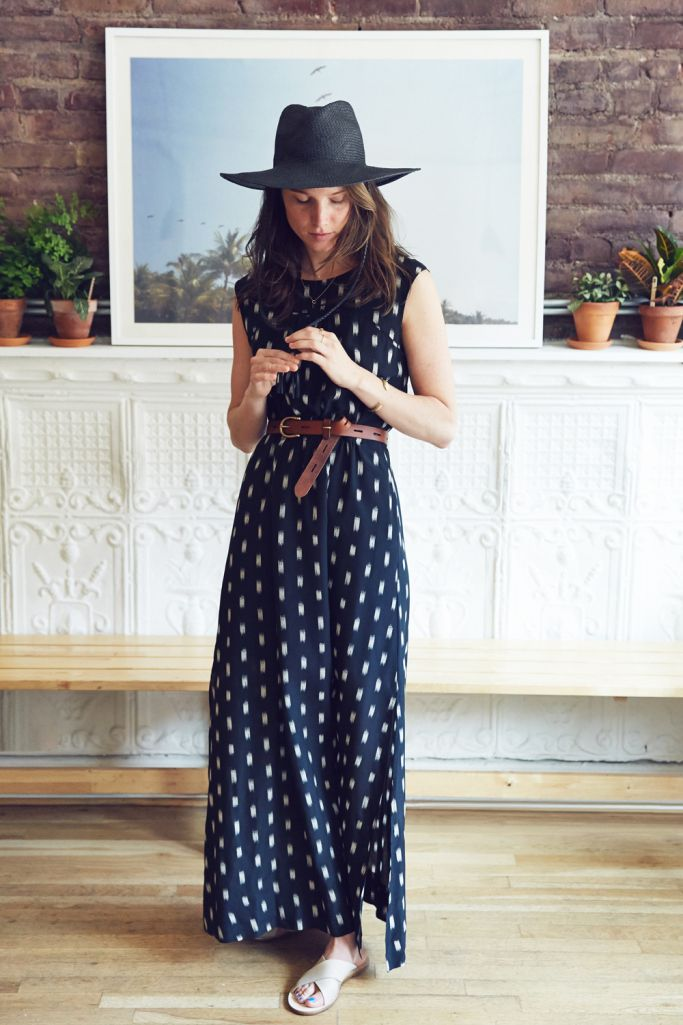 Emma is wearing a Madewell Ikat Brush Maxi Dress with a Straw Mesa Hat, Backcountry Belt and The Sightseer Slide Sandal.