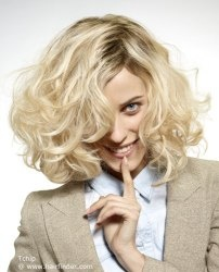 Medium length hairstyle with curls and a sleek crown