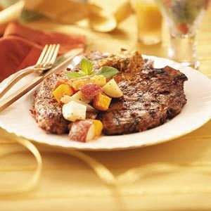 T-Bones with Sun-Dried Tomato Butter Recipe from Taste of Home | Take T-bone steaks to a new level by topping individual servings with a dollop of savory butter seasoned with sun-dried tomato pesto.