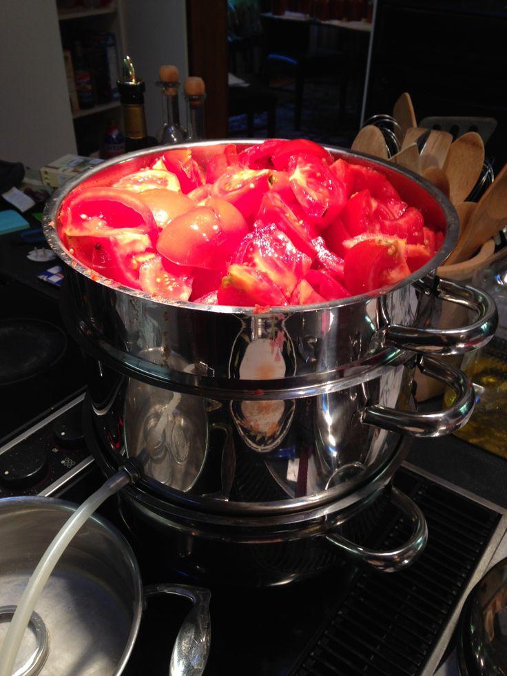Steam juicer full of fresh tomatoes