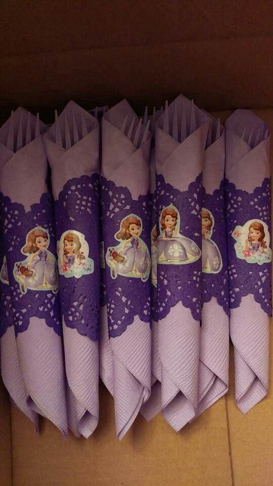 Sofia the First birthday party napkins... Silverware wrapped in colored napkins, wrapped in paper lace doilies and secured with a Sofia sticker.