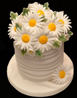 Daisy pillar cake which gives a fantastic bright look to any table centre.