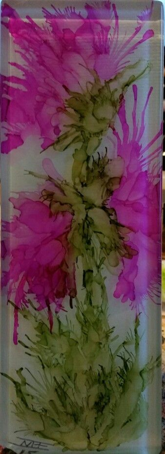 Flower in alcohol ink on glass tile.