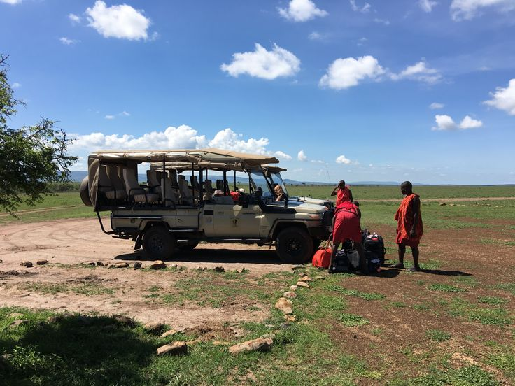 Masi Tribe helping us with our bags then off for a safari drive.