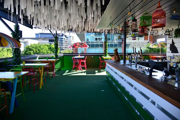 Main bar area and green flooring inside the Dandys Rooftop