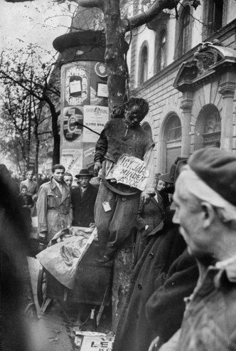 Not published in LIFE. Street justice meted out by rebel fighters during the Hungarian Revolution, 1956.  10 of 29