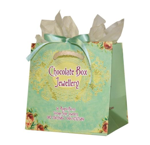 #Custombags #carrierbags #uniquebags #ribbonbags Custom Printed Jewellery Paper Bag featuring modern mint colour palette. With ribbon and rope handle.