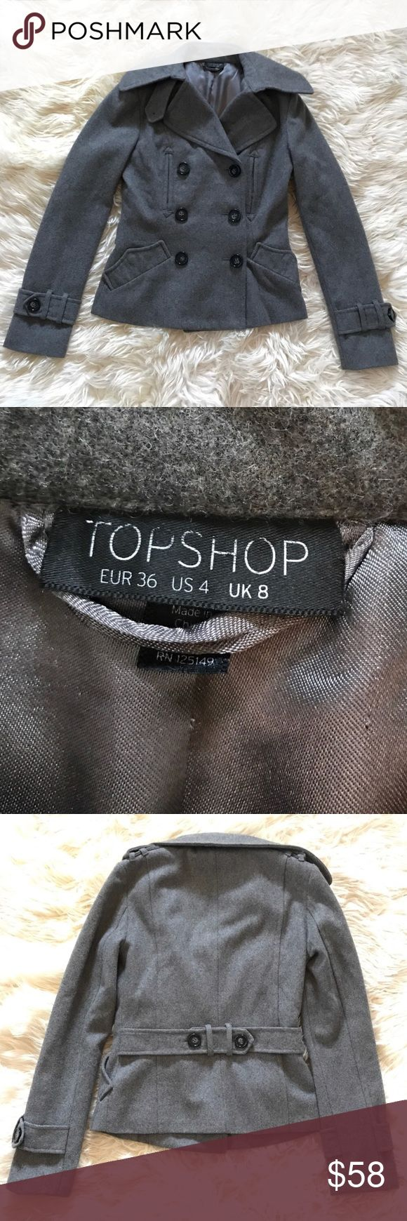 Topshop Grey Pea Coat Size 4 Topshop grey wool pea coat in like great condition. This jacket has Button details on the sleeve cuffs, back and shoulders. Super warm, size 4. Topshop Jackets & Coats