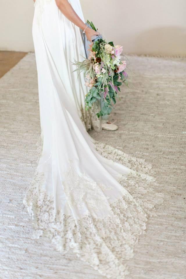 Christill's dramatic train with Chantilly lace trim hand sewn onto dress hem.