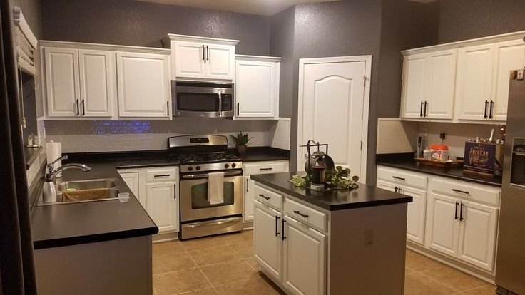 We used Rustoleum dark tint countertop paint to cover our ...