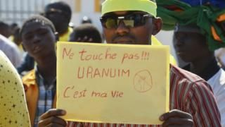 Image copyright                  AFP             Image caption                                      Students and civil society activists in Niger believe they do not get a fair share from their country's uranium trade                               Activists in Niger...
