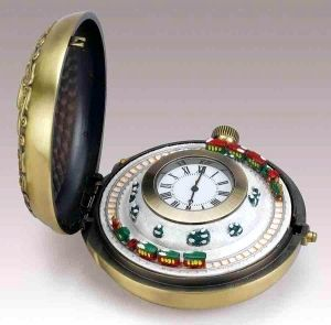 Musical metal pocket watch with miniature animated scene made by Mr Christmas - Item# for this Mr Christmas musical pocket watch : 77752