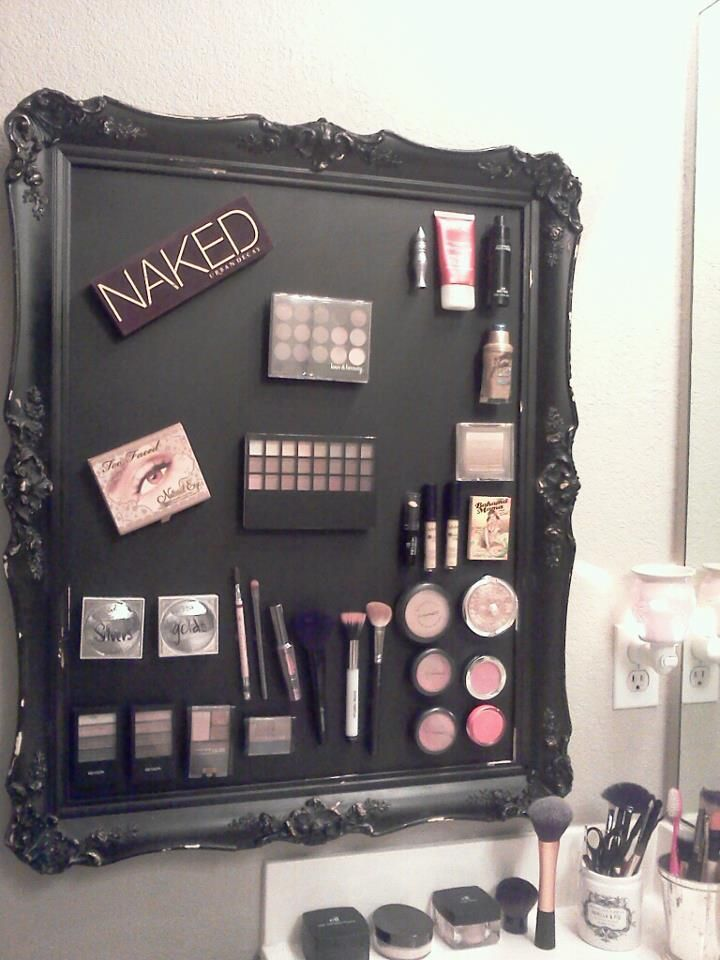 Framed magnetic wall makeup organizer. I used  a vintage frame. Bought sheet metal from Home Depot and cut it to size. Spray painted both and hot glued them together. Bought magnets at Michaels and hot glued them to the back of my makeup.