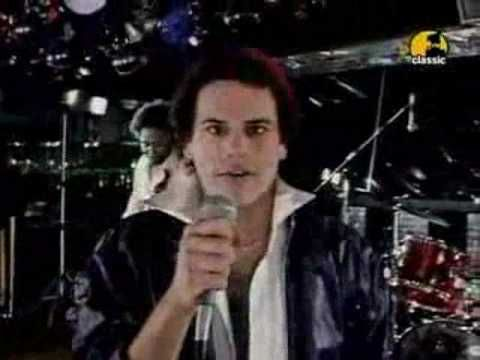"KC and the Sunshine Band - ""Please Don't Go"". KC is perfectly intense here."