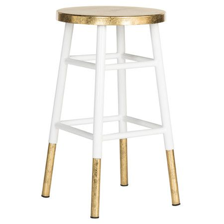 Dipped in a shimmering gold finish, this crisp white stool adds a touch of glamour to your home bar or kitchen island.Product: St...