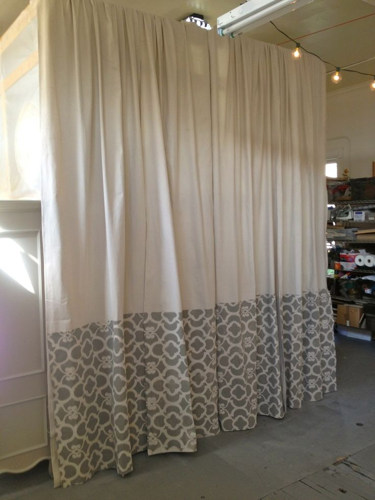Stencil paint with ASCP on the bottom of a drop cloth and use as curtain!