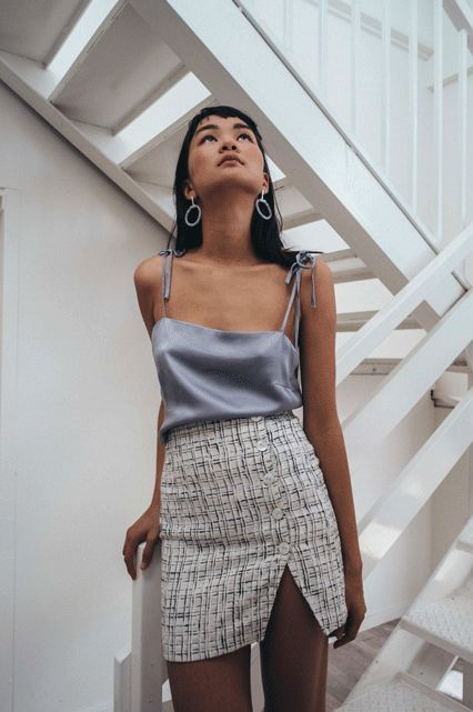 Gray silk top paired with a split skirt and hoop earrings.   <3 @benitathediva