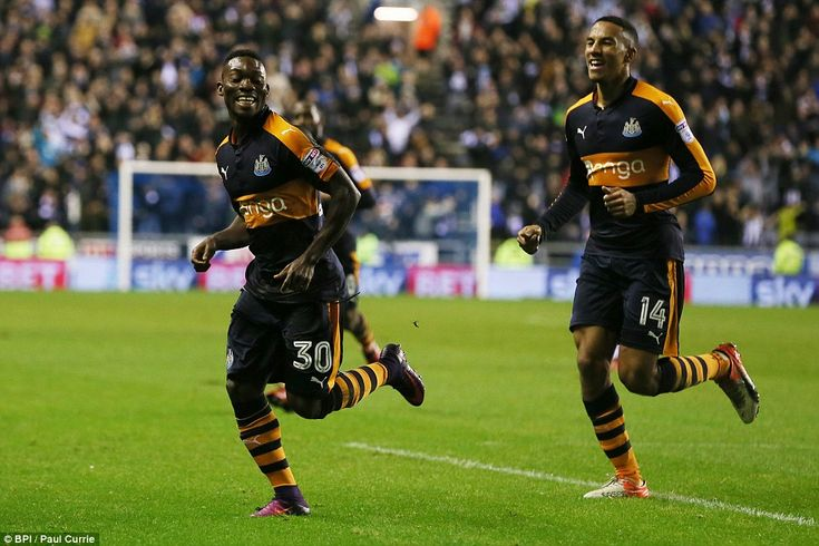Substitute Christian Atsu (left) runs off to celebrate after scoring Newcastle's second goal of the night against Wigan