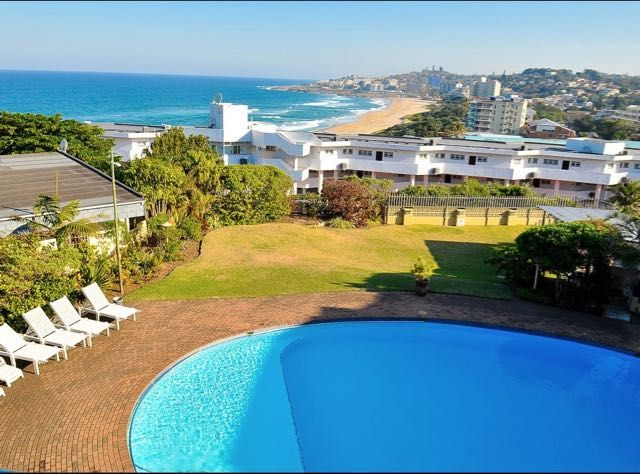 16 La Luce in Margate (Self-Catering). Stunning seaview, perfect sunsets on a balcony to enjoy sundowners. Massive pool and braai facilities. 2 bedrooms and a sleeper couch in the lounge. 6 sleeper unit.