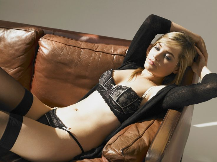 Laura Whitmore kicks back in lacy black undies and stockings ahead of Strictly debut