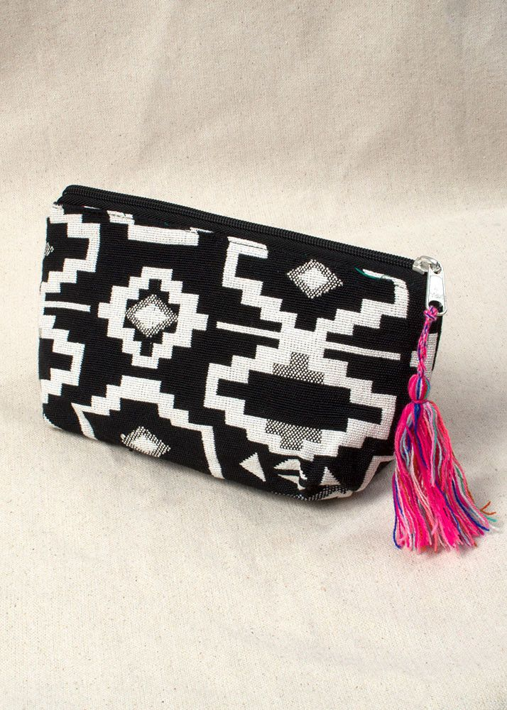 This black and white aztec zip up pouch will quickly become one of your…