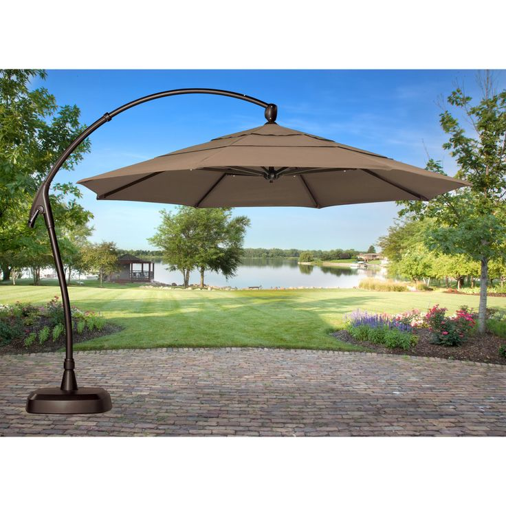 It is an umbrella on a frame that is set to the side and cantilevers over the shade area. Description from plainandsimpledeals.com. I searched for this on bing.com/images