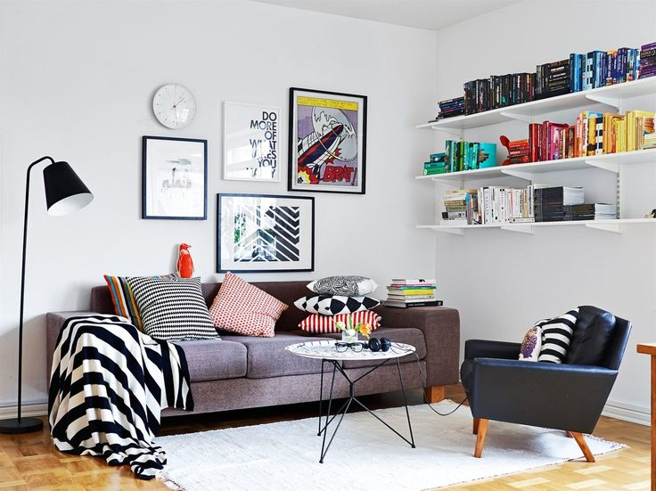 Colorful Scandinavian living room, books displayed by color