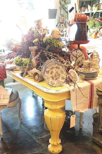 Robin's Vintage Suitcase Shop (I am going crazy over that gorgeous table!)