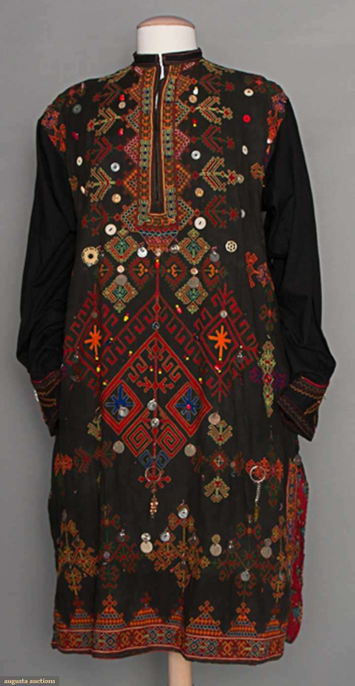 Pakistan dress, black cotton, front covered w/ geometric embroidery in bright colors & trimmed in beads, buttons & coins, side slits, early-mid 20th c